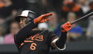 Baltimore Orioles' Jonathan Schoop follows through on a solo home run against the Tampa Bay Rays in the fifth inning of a baseball game, Friday, July 27, 2018, in Baltimore. (AP Photo/Gail Burton) **FILE**