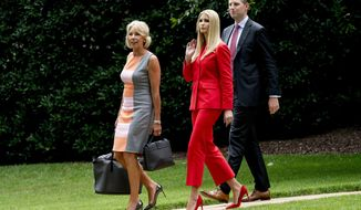 Ivanka Trump, cdenter, the daughter of President Donald Trump, Education Secretary Betsy DeVos, left, and Eric Trump, the son of President Donald Trump, walk towards Marine One at the White House in Washington, Tuesday, July 31, 2018, for a short trip to Andrews Air Force Base, Md., and then on to Tampa, Fla. to accompany President Donald Trump to a rally. (AP Photo/Andrew Harnik)