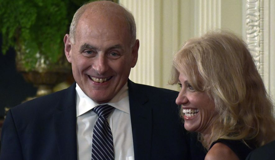 White House chief of staff John Kelly, left, and White House counselor Kellyanne Conway laugh before the start of a news conference with President Donald Trump and Italian Prime Minister Giuseppe Conte in the East Room of the White House in Washington, Monday, July 30, 2018. (AP Photo/Susan Walsh)