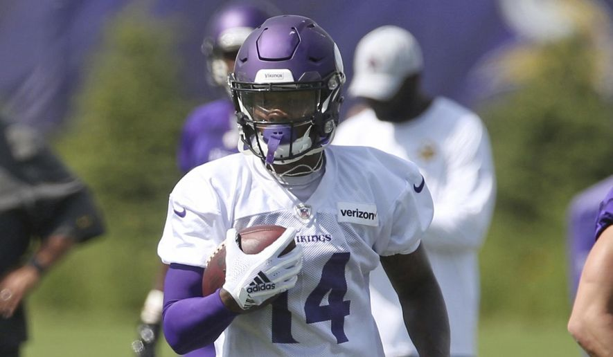 Minnesota Vikings wide receiver Stefon Diggs carries the ball during NFL football practice in Eagan, Minn., Saturday, July 28, 2018. (AP Photo/Jim Mone) **FILE**