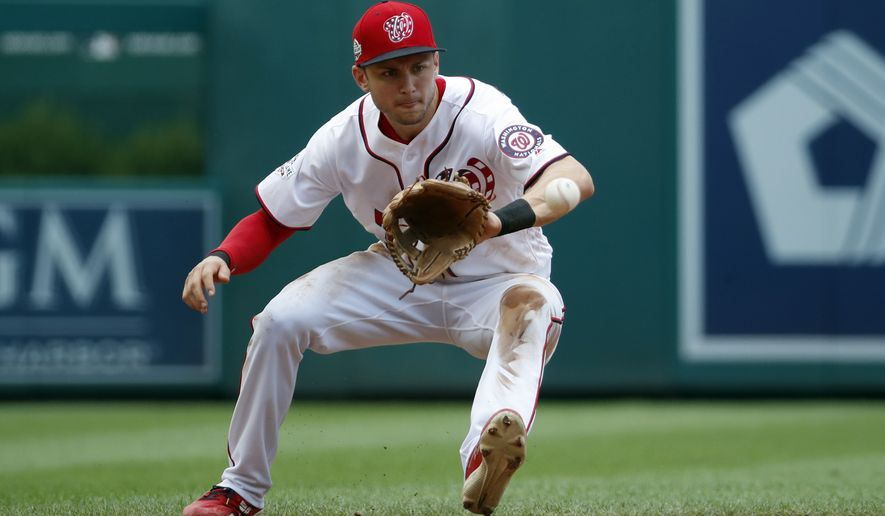 Washington Nationals shortstop Trea Turner (7) fields a ground ball during a baseball game against the New York Mets at Nationals Park, Wednesday, Aug. 1, 2018, in Washington. (AP Photo/Alex Brandon)