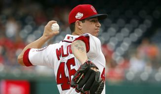 Washington Nationals starting pitcher Tommy Milone throws during the third inning of a baseball game against the New York Mets at Nationals Park, Wednesday, Aug. 1, 2018, in Washington. (AP Photo/Alex Brandon)