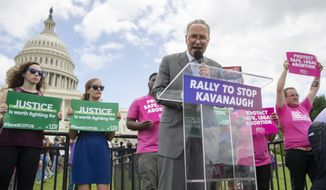 Senate Minority Leader Chuck Schumer, D-N.Y., joins protesters objecting to President Donald Trump's Supreme Court nominee Brett Kavanaugh, at a rally Capitol in Washington, Wednesday, Aug. 1, 2018. (AP Photo/J. Scott Applewhite)