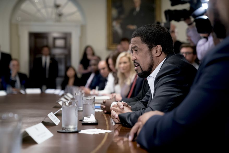Pastor Darrell Scott speaks during a meeting with President Donald Trump and inner-city pastors in the Cabinet Room of the White House in Washington, Wednesday, Aug. 1, 2018. (AP Photo/Andrew Harnik)