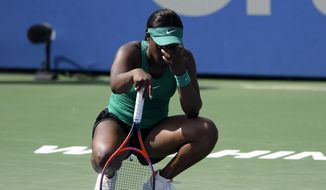 Sloane Stephens, of the United States, reacts during her match against Andrea Petkovic, of Germany, during the Citi Open tennis tournament Wednesday, Aug. 1, 2018, in Washington. (AP Photo/Nick Wass)