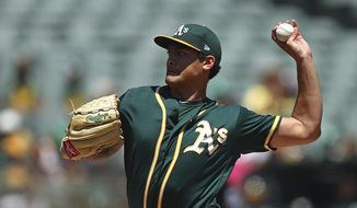 Oakland Athletics pitcher Sean Manaea works against the Toronto Blue Jays in the first inning of a baseball game Wednesday, Aug. 1, 2018, in Oakland, Calif. (AP Photo/Ben Margot)