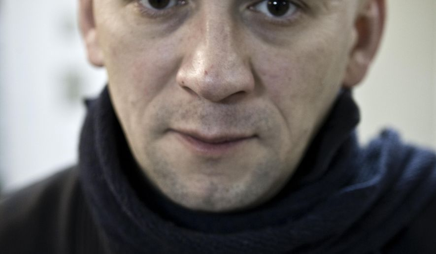 In this photo taken on Tuesday, Jan. 18, 2011, Russian documentary filmmaker Alexander Rastorguyev poses for a photo in Moscow, Russia . Three Russian journalists were killed in an ambush outside the town of Sibut in Central African Republic, officials in both countries said Tuesday, July 31, 2018. The Russian Foreign Ministry identified the slain journalists as Kirill Radchenko, Alexander Rastorguyev and Orkhan Dzhemal. (AP Photo/Alexei Maishev)