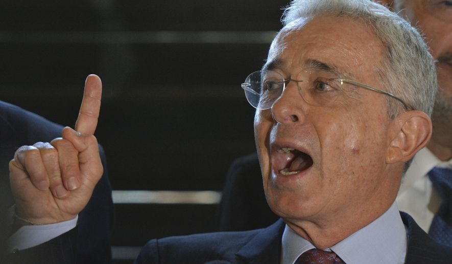 Former Colombian President and Sen. Alvaro Uribe speaks during a press conference at his home in Rionegro, Colombia, Monday, July 30, 2018, a week after Colombia's Supreme Court ordered him to testify on allegations of witness tampering. Uribe gave a detailed explanation in refuting the accusations against him. (AP Photo/Luis Benavides)