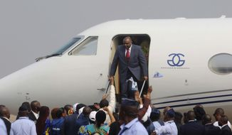 Congo's former Vice President Jean-Pierre Bemba disembarks a private jet upon his arrival at the airport in Kinshasa, Democratic Republic of Congo, Wednesday, Aug 1, 2018. Bemba returned to the country on Wednesday to register as a presidential candidate in December's long-delayed election, more than a decade after his arrest in Belgium led to a trial at the International Criminal Court over war crimes. (AP Photo/John Bompengo)