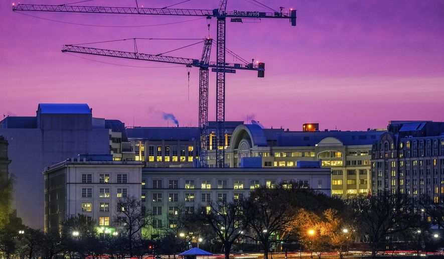 FILE - In this March 27, 2018 file photo, construction cranes in Southwest Washington are silhouetted against the morning sky as redevelopment continues in the waterfront area of the District of Columbia.  Spending on U.S. construction projects fell 1.1 percent in June, the biggest decline in more than a year as spending on public construction dropped at the highest rate in more than five years. The Commerce Department says the decline in June brought total construction spending to a seasonally-adjusted $1.32 trillion, 6.1 percent higher than a year ago. (AP Photo/J. David Ake, File)