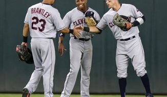 Cleveland Indians outfielders Michael Brantley (23), Greg Allen, center, and Brandon Guyer celebrate at the end of a baseball game against the Minnesota Twins on Tuesday, July 31, 2018, in Minneapolis. The Indians defeated the Twins 6-2. (AP Photo/Andy Clayton-King)