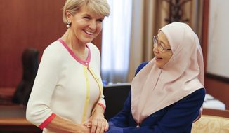 Australian Foreign Affairs Minister Julie Bishop, left, shakes hands with Malaysian Deputy Prime Minister Wan Azizah Wan Ismail at parliament building in Kuala Lumpur, Wednesday, Aug. 1, 2018. (AP Photo/Vincent Thian)