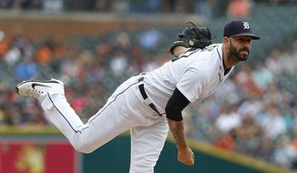 Detroit Tigers pitcher Mike Fiers throws against the Cincinnati Reds in the first inning of a baseball game in Detroit, Wednesday, Aug. 1, 2018. (AP Photo/Paul Sancya)