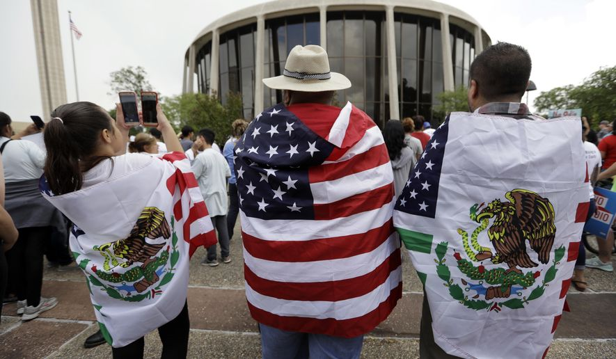 """FILE - In this June 26, 2017, file photo, protesters take part in a rally to oppose a new Texas """"sanctuary cities"""" bill that aligns with the president's tougher stance on illegal immigration, in San Antonio, Texas, outside of the Federal Courthouse. A U.S. appeals court says President Donald Trump's executive order threatening to withhold funding from """"sanctuary cities"""" that limit cooperation with immigration authorities is unconstitutional. But the 9th U.S. Circuit Court of Appeals on Wednesday, Aug. 1, 2018, said a lower court went too far when it blocked the order nationwide. (AP Photo/Eric Gay, File)"""