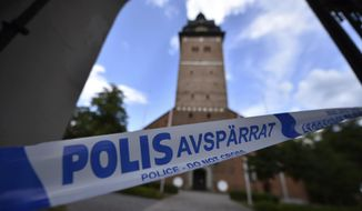 In this Tuesday, July 31, 2018 photo, a police cordon near the scene of a robbery at the Strangnas Cathedral, in Strangnas, Sweden. Police say thieves have stolen priceless treasures from the Swedish royal regalia, including a jeweled crown, from a cathedral where they were on display, before speeding off by motorboat.  (Pontus Stenberg/TT News Agency via AP)