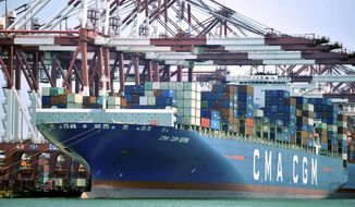 In this July 6, 2018, file photo, a container ship is docked at a port in Qingdao, in eastern China's Shandong Province. (Chinatopix via AP, File)