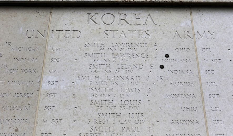 The Honolulu Memorial Korean War Courts of the Missing memorial wall is shown at the National Memorial Cemetery of the Pacific in Honolulu on Monday, July 30, 2018. The names of all U.S. soldiers who did not return from the Korean War are listed on the memorial. Human remains handed over to the U.S. government from North Korea are expected to arrive Wednesday in Honolulu, where scientists will begin the painstaking process of trying to match DNA from the bones to those of American soldiers who didn't return from the Korean War more than a half century ago. (AP Photo/Caleb Jones)