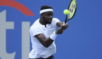 Frances Tiafoe returns the ball against Hubert Hurkacz, of Poland, during the Citi Open tennis tournament, Wednesday, Aug. 1, 2018, in Washington. (AP Photo/Nick Wass)