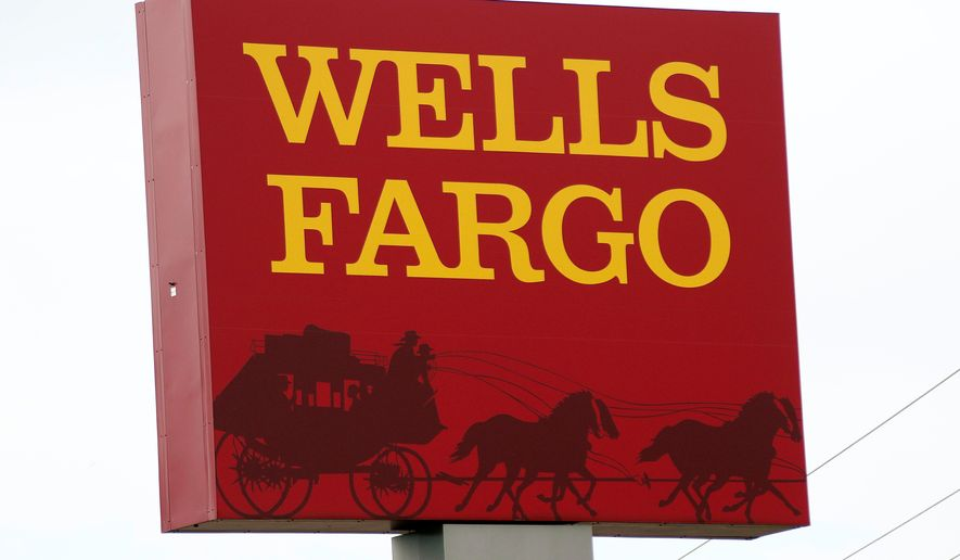 FILE - This April 11, 2017, photo shows a Wells Fargo bank in northeast Jackson, Miss. Wells Fargo agreed Wednesday, Aug. 1, 2018, to pay a $2.1 billion fine to settle allegations it misrepresented the types of mortgages it sold to investors during the housing bubble that ultimately led to the 2008 financial crisis. (AP Photo/Rogelio V. Solis, File)