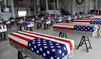 Transfer cases are in a hanger at a ceremony marking the arrival of the remains believed to be of U.S. service members who died in the Korean War in Hawaii, on Wednesday. (ASSOCIATED PRESS)