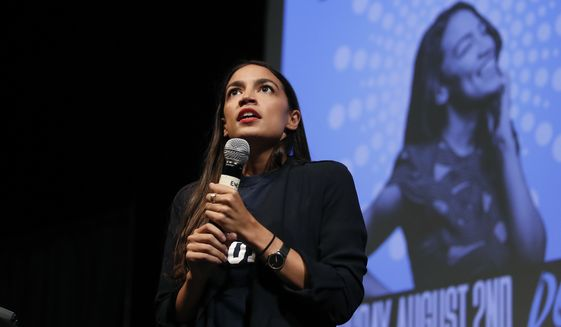 Alexandria Ocasio-Cortez, a winner of a Democratic Congressional primary in New York, addresses supporters at a fundraiser Thursday, Aug. 2, 2018, in Los Angeles. (AP Photo/Jae C. Hong) ** FILE **