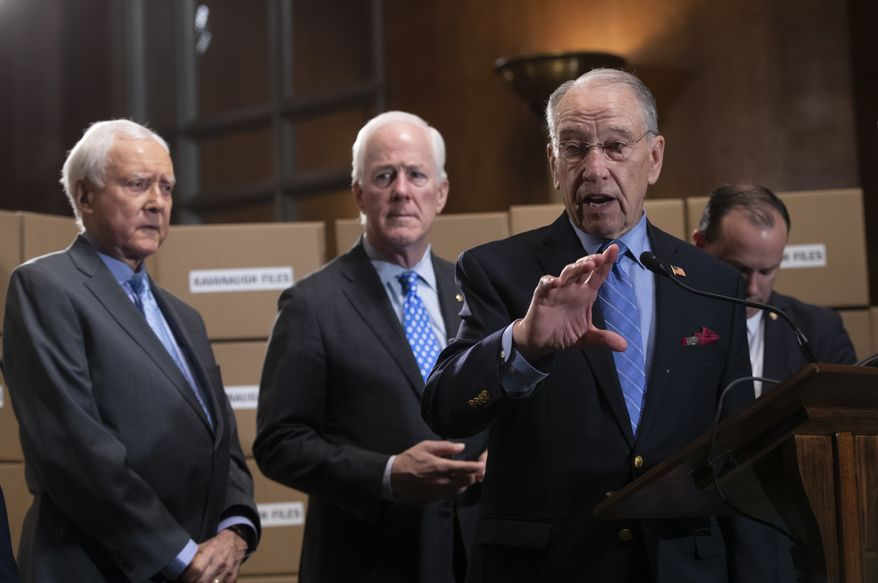 Senate Judiciary Chairman Chuck Grassley, R-Iowa, joined from left by Sen. Orrin Hatch, R-Utah, Sen. John Cornyn, R-Texas, and Sen. Mike Lee, R-Utah, holds a news conference to refute Senate Democrats who are intensifying their fight over documents related to Supreme Court nominee Brett Kavanaugh's stint as staff secretary at the White House, on Capitol Hill in Washington, Thursday, Aug. 2, 2018. (AP Photo/J. Scott Applewhite)
