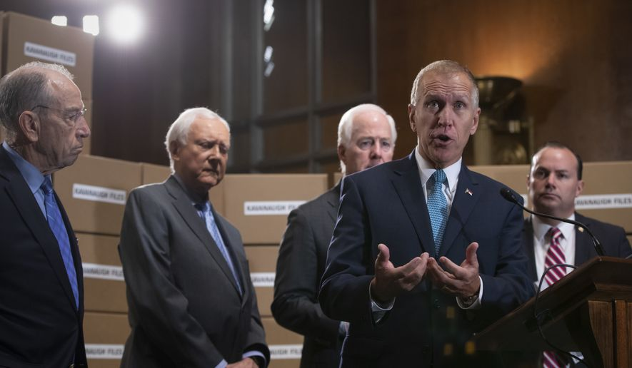 From left, Senate Judiciary Chairman Chuck Grassley, R-Iowa, Sen. Orrin Hatch, R-Utah, Sen. John Cornyn, R-Texas, Sen. Thom Tillis, R-N.C., and Sen. Mike Lee, R-Utah, hold a news conference to refute Senate Democrats who are intensifying their fight over documents related to Supreme Court nominee Brett Kavanaugh's stint as staff secretary at the White House, on Capitol Hill in Washington, Thursday, Aug. 2, 2018. (AP Photo/J. Scott Applewhite)
