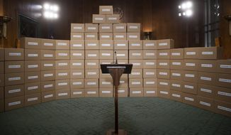 """A wall of empty cardboard boxes labeled """"Kavanaugh Files"""" was erected as a backdrop for a news conference by Republican members of the Senate Judiciary Committee last week. The boxes are supposed to represent the large number of documents Senate Democrats have requested to review Supreme Court nominee Brett M. Kavanaugh's record. (Associated Press/File)"""
