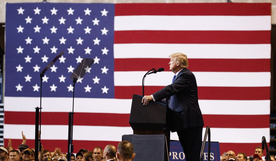 President Donald Trump pauses as he speaks during a rally, Thursday, Aug. 2, 2018, at Mohegan Sun Arena at Casey Plaza in Wilkes Barre, Pa.. (AP Photo/Carolyn Kaster)