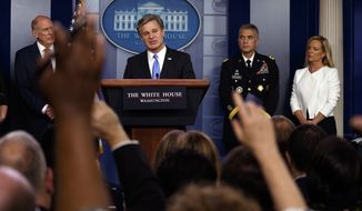 FBI Director Christopher Wray speaks during the daily press briefing at the White House, Thursday, Aug. 2, 2018, in Washington, as from left, Director of National Intelligence Dan Coats, National Security Agency Director Gen. Paul Nakasone, and Secretary of Homeland Security Kirstjen Nielsen listen. (AP Photo/Evan Vucci)