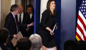 White House press secretary Sarah Huckabee Sanders arrives for the daily press briefing at the White House, Thursday, Aug. 2, 2018, in Washington. (AP Photo/Evan Vucci)