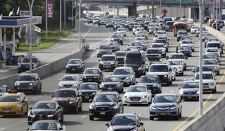 In this Aug. 1, 2018, photo, cars on the Grand Central Parkway pass LaGuardia Airport in New York. The Trump administration has proposed rolling back tougher Obama-era gas mileage requirements that are set to take effect after 2020. (AP Photo/Frank Franklin II)