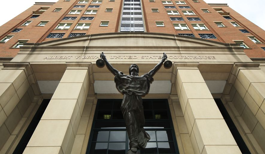 A statue adorns the front of the Albert V. Bryan United States Courthouse, Thursday, Aug. 2, 2018 in Alexandria, Va., where President Donald Trump's former campaign chairman Paul Manafort is on trial facing federal charges of tax evasion and bank fraud. (AP Photo/Manuel Balce Ceneta)