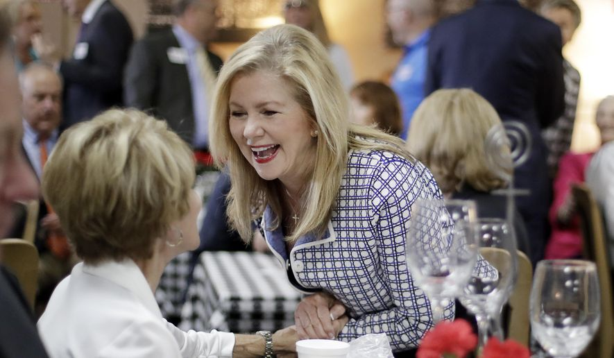Republican U.S. Rep. Marsha Blackburn campaigns Thursday, Aug. 2, 2018, at a cafe in Brentwood, Tenn. Blackburn and former Democratic Gov. Phil Bredesen face only nominal opposition in their primaries for U.S. Senate. (AP Photo/Mark Humphrey)