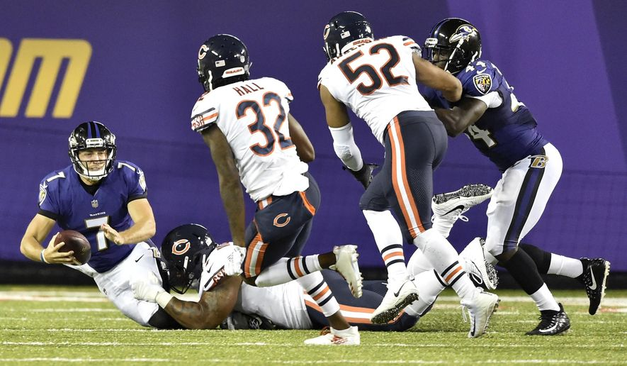 Baltimore Ravens quarterback Josh Woodrum (7) is sacked in the first half against the Chicago Bears at the Pro Football Hall of Fame NFL preseason game, Thursday, Aug. 2, 2018, in Canton, Ohio. (AP Photo/David Richard)
