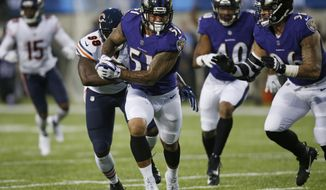 Baltimore Ravens linebacker Kamalei Correa (51) runs after an interception against the Chicago Bears during the first half at the Pro Football Hall of Fame NFL preseason game Thursday, Aug. 2, 2018, in Canton, Ohio. (AP Photo/Ron Schwane)