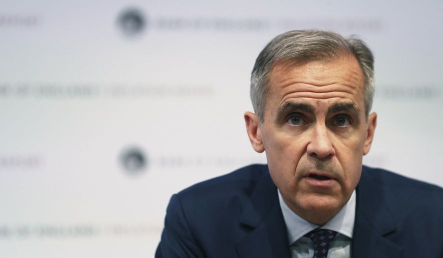 Bank of England Governor, Mark Carney, speaks during a media conference to present the central bank's quarterly Inflation Report, in London, Thursday Aug. 2, 2018. The Bank of England raised its main interest rate for only the second time since the 2008 financial crisis, from 0.50 percent to 0.75 percent, as it weighed conflicting signs about the economy and growing concerns about Brexit.(Daniel Leal-Olivas/Pool via AP)