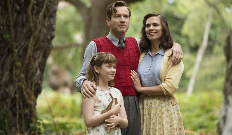 "This image released by Disney shows, from left, Bronte Carmichael, Ewan McGregor and Hayley Atwell in a scene from ""Christopher Robin."" (Laurie Sparham/Disney via AP)"