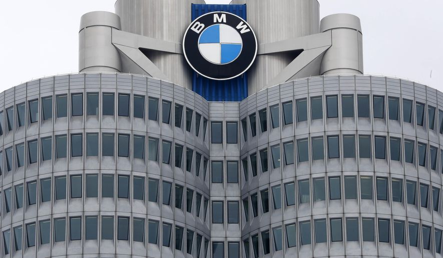 FILE - In this Wednesday, March 21, 2018 file photo, the logo of German car manufacturer BMW is pictured at the headquarters in Munich, Germany. German carmaker BMW reports its second quarter earnings on Thursday, Aug. 2, 2018. (AP Photo/Matthias Schrader, file)