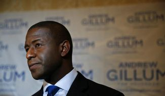 Democratic gubernatorial candidate Andrew Gillum speaks to the media after a debate ahead of the Democratic primary for governor on Thursday, Aug. 2, 2018, in Palm Beach Gardens, Fla. (AP Photo/Brynn Anderson)