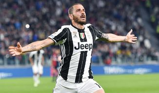FILE - In this Sunday, April 23, 2017 filer, Juventus' Leonardo Bonucci celebrates after scoring a goal during the Serie A soccer match between Juventus and Genoa at the Juventus stadium in Turin, Italy.Bonucci won six Serie A titles in seven years at Juventus but the Italy defender joined Milan last year _ in what was the shock of the transfer window _ for a fee of more than 40 million euros ($45 million) amid reports of a dressing room spat. Juventus said on Thursday that the 31-year-old Bonucci, who has reportedly taken a pay cut to move back to Juventus, has signed a five-year deal. (Alessandro Di Marco/ANSA via AP)