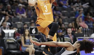Las Vegas Aces guard Jaime Nared (31) falls to the floor after fouling Phoenix Mercury guard Diana Taurasi (3) during the first half of a WNBA basketball game Wednesday, Aug. 1, 2018, in Las Vegas. (AP Photo/John Locher)