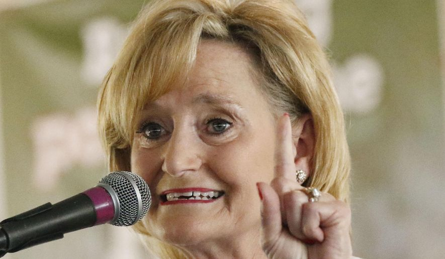 U.S. Sen. Cindy Hyde-Smith, R-Miss., reminds voters that she is ready for the fight to win a special election to fill the final two years of a term started by Republican U.S. Sen. Thad Cochran of Mississippi at one of the biggest political events of the year in the state, the Neshoba County Fair, Thursday , Aug. 2, 2018, in Philadelphia, Miss. Hyde-Smith was appointed by Gov. Phil Bryant to assume the position until a election could be held to fill the post. (AP Photo/Rogelio V. Solis)