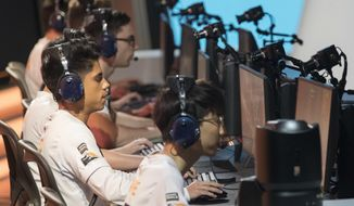 FILE - In this July 28, 2018, file photo, Philadelphia Fusion players compete against the London Spitfire during the Overwatch League Grand Finals at Barclays Center in the Brooklyn borough of New York. The Overwatch League has announced that Atlanta will join the global, city-based esports circuit for its second season in 2019. The team will be managed by Atlanta Esports Ventures, a partnership between Cox Enterprises and Province, Inc. (AP Photo/Mary Altaffer, File)