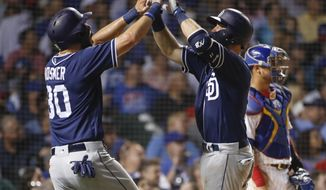 San Diego Padres' Austin Hedges, right front, celebrates with Eric Hosmer after hitting three-run home run off Chicago Cubs' Jesse Chavez during the sixth inning of a baseball game Thursday, Aug. 2, 2018, in Chicago. (AP Photo/Kamil Krzaczynski)