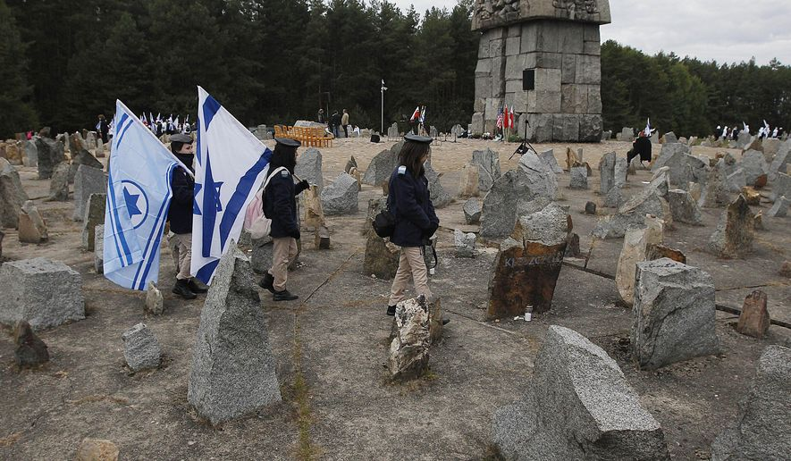 In this Wednesday, Oct. 2, 2013 Photo Israeli youths with their national flags march by the monument to some 900,000 European Jews killed by the Nazis between 1941 and 1944 at the Treblinka death and labor camp, at Treblinka memorial, Poland. Ada Krystyna Willenberg, the widow of one revolt fighter Samuel Willenberg, appealed Thursday for a proper museum to be built at the site of the former camp. The current memorial consists of boulders bearing the names of locations that the inmates came from. (AP Photo/Czarek Sokolowski, file)