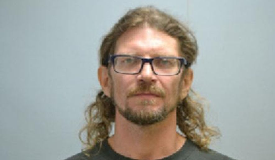This undated photo provided by  Lee County Jail shows Michael Alan Cheeseman who was being held on a charge of trafficking marijuana in Lee County, N.C.  . A Lee County Sheriff's Office statement says Cheeseman was arrested after a raid Wednesday, Aug. 1, 2018,  that shut down a sophisticated growing operation at a home in Broadway. (Lee County Jail via AP)