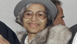 FILE - This Oct. 28, 1986, file photo shows Rosa Parks at Ellis Island in New York. A letter written by Parks describing the 1957 bombing of neighbors' home has been purchased at auction by the couple who were targeted in the attack. Alabama State University announced that the Rev. Robert Graetz and his wife Jeannie purchased the letter by Parks describing the bombing of their home. (AP Photo/File)