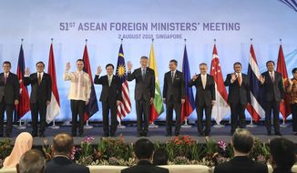 ASEAN foreign ministers pose for a photo ahead of the 51st ASEAN Foreign Ministers Meeting in Singapore, Thursday, Aug. 2, 2018. From left to right are Laos' Saleumxay Kommasith, Malaysia's Saifuddin Abdullah, Myanmar's U Kyaw Tin, Philippines' Alan Cayetano, Vietnam's Pham Binh Minh, Singapore's Prime Minister Lee Hsien Loong, Singapore's Vivian Balakrishnan, Thailand's Don Pramudwinai, Brunei's Erywan Yusof, Cambodia's Perak Sokhonn, Indonesia's Retno Marsudi and ASEAN Secretary-General Lim Jock Hoi. (AP Photo/Yong Teck Lim)