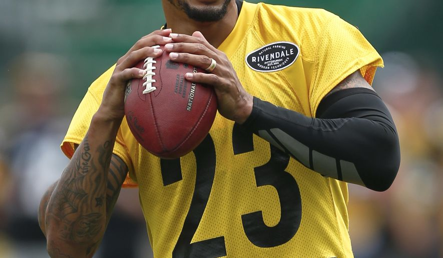 FILE - In this July 27, 2018, file photo, Pittsburgh Steelers defensive back Joe Haden warms up at practice during NFL football training camp in Latrobe, Pa. Haden and Artie Burns are hoping a full offseason and training camp together can help the Steelers defensive backs regain some of their swagger in 2018. (AP Photo/Keith Srakocic, File)